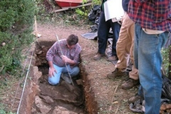 Bob Jolley inspects an exploratory trench.