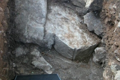 The dig uncovered this rock bearing the drill shaft Washington's workers used to blast the rock.